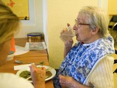 Older person receiving help from their carer.
