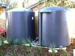 Glenroy Community Centre two large Water Tanks in garden