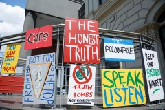 Collective Care protest banner installation