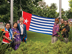 (L-R): Ivone Bukorpioper, Natalie Adidikam, Cr Mark Riley, Alfons Adidikam, Babuan Mirino and Emil Wainggai, ahead of raising the flag on Friday.