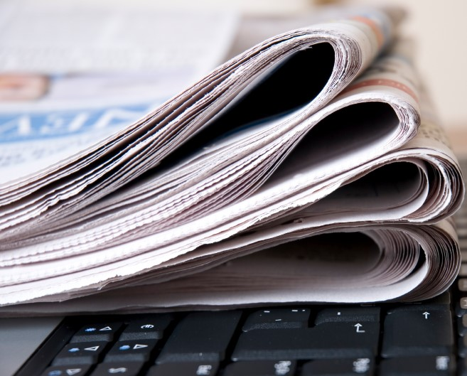 Image of newspapers on a laptop