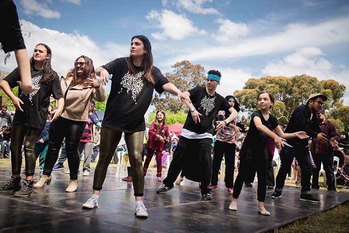 Dance group performing on stage at Fawkner Festa
