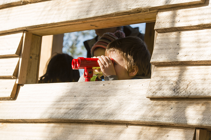 Children using the binoculars at the Kirkdale Park playspace