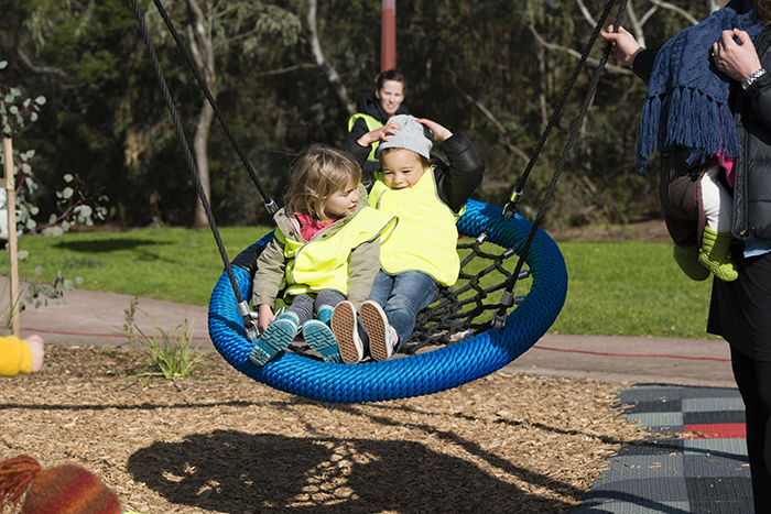 Children sharing a swing at Kirkdale Park playspace