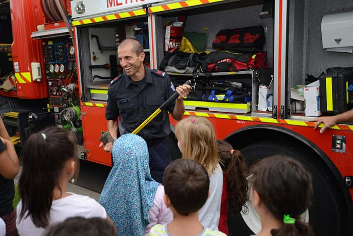 Primary school holiday program children thank fire fighters