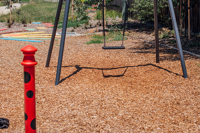 Play equipment and landscaping at Merlynston Creek Park.